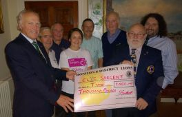Lions group round Joy from CLIC Sargent with £2000