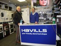 Lion Ron Webb with Clifford Hamstead from Havills work together to supply cooker to local resident