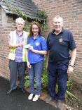 Girl Guide Phoebe Roberts receiving £100 from Honiton Lions
