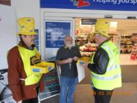 Lions collecting at Tesco Honiton for Marie Curie