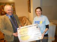 Lion President Steve Presenting the cheque to Natalie Searle from Marie Curie