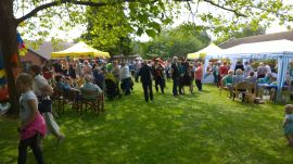 Crowds at the fete by Lions plate smashing stand