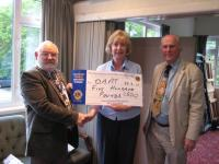 Presentation of £500 cheque to Maggie Little from DAAT