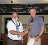Lion President Brian thanking Lions Steve for a pint