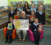 Lion Ron presenting cheque for £250 towards new library