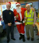 Lions Tom and Ron with Lion Santa Bob