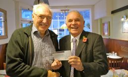 Lion Bob presentating £250 to Colin Wright towards towns Christmas lights as thank you.