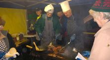 Through the smoke and fire, the Lions chefs work on