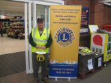 Lion Bill working the bucket at Tesco Honiton