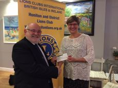 Past President Brian presents £1000 to The Project