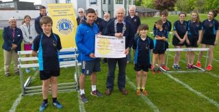 Lion President Steve presenting Andy Taylor Head of Sport & PE with £500