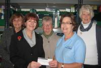 Lions\' Ladies presenting a cheque for £250 to Teresa Hawkes, Manager at The King\'s Centre Food Bank