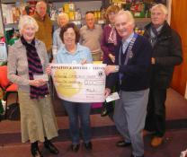 Lions and Lions Ladies give £100 each to Honiton Foodbank