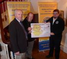 Lion President Steve presenting the Devon Free Wheelers with a cheque for £1000