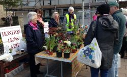 Lions Ladies with their plant stand on a cold but bright day