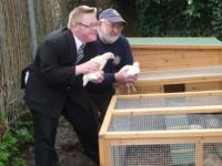 Lion President Brian Richards with Chickens and one of the pupils
