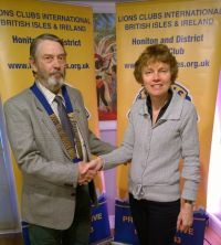 Lion President John with grant of £160 to Ruth Bizley