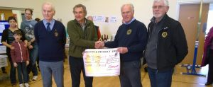 Lion President Steve presents Dr Tim Cox with donation of �200 towards defibrillator