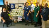 Lions with the 15 funded blood pressure monitors presented to Honiton Surgery