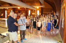 Lion President Brian with Lion Kev presenting £100 to swimming club