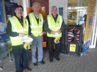 Changeover at Tesco Easter collection with Lions Bernard, Roy and Barry collecting
