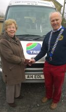 Lion President with TRIP Chairman Val Royle following £500 grant for uniforms
