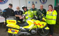 Lions £2100 DeFib being installed on First responder bike