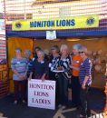 Lions Laddies line up in the plate smashing stall.
