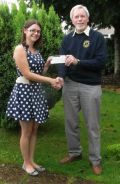 Lion Tom presenting Charlotte Miller-Ratcliffe with cheque for £100