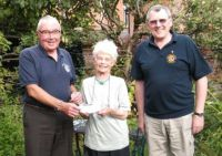 Lions Bill and Barnard presenting the cheque for £250 to Vision OM