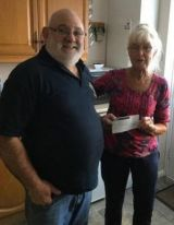 Winnie collects £300 from Lion President Brian